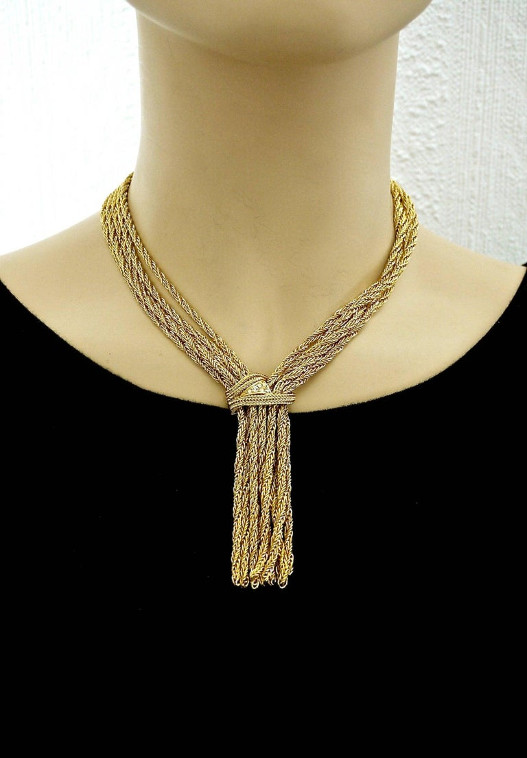 Vintage 1967 CHRISTIAN DIOR Cascading Multi Chain Rhinestone Tassel Necklace  Measurements: Pendant Height: 3.35 inches (8.5 cm) Wearable Length: 16.7 inches (42.5 cm)  Features: - 100% Authentic CHRISTIAN LACROIX. - 5 twisted chains on each side