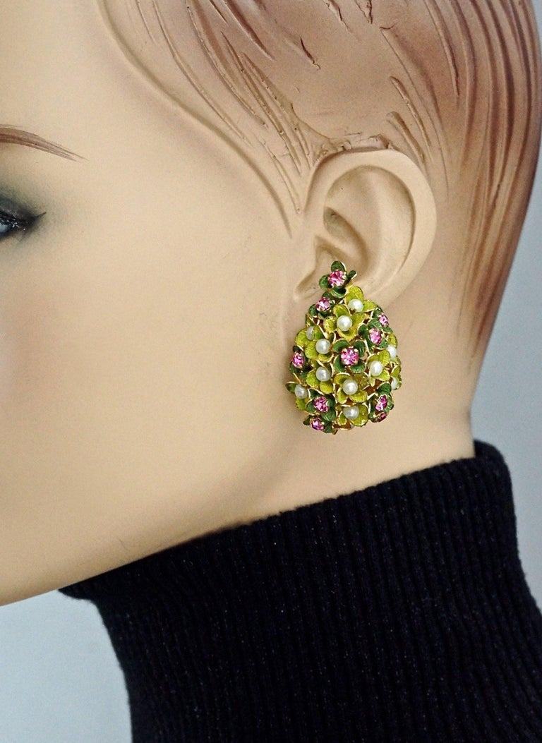 Vintage 1967 CHRISTIAN DIOR Cluster Enamel Flower Pearl Rhinestone Earrings  Measurements: Height: 1.65 inch (4.2 cm) Width: 1.10 inches (2.8 cm) Weight: 13 grams  Features: - 100% Authentic CHRISTIAN DIOR. - Cluster enamel flowers embellished with