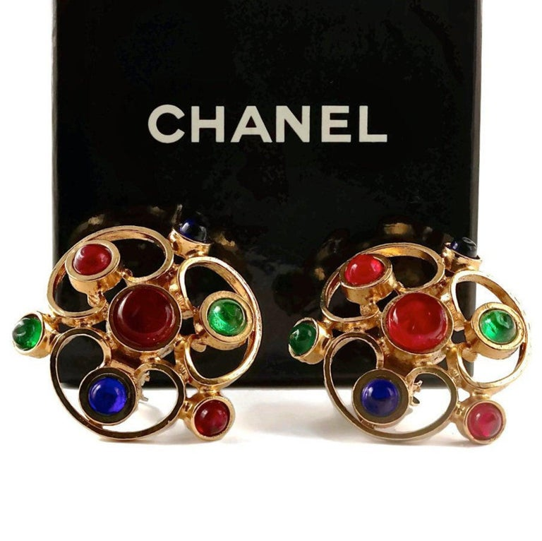 Vintage 1970 Massive CHANEL Gripoix Openwork Earrings  Measurements: Height: 2 1/8 inches (5.39 cm) Width: 2 inches (5.08 cm)  Features: - 100% Authentic CHANEL. - Massive openwork earrings. - Embellished with Sapphire, Emerald and Ruby gripoix. -