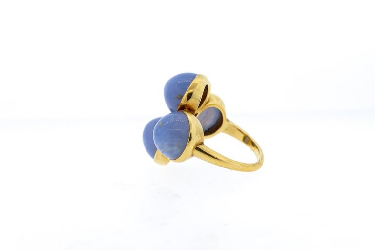 A vintage 18k yellow gold Cartier ring set with cabochon chalcedony, circa 1970. The ring is a true funky design for an unusual cocktail ring. The ring is signed Cartier London, where they often created avant- garde designs to reflect modern styles.