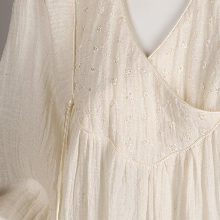 Beautifully done vintage 1970s off white cotton gauze peasant style dress with full blouson sleeves and eyelet fabric detail at the bust. This fabric is very light weight and almost sheer. Empire waist. Unlined with no closure (pulls on over the