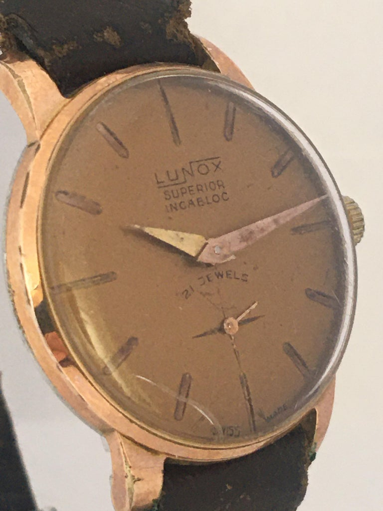 This beautiful pre-owned vintage hand-winding ladies watch is working and ticking well. Visible signs of ageing and wear with scratches on the glass and on the gold plated watch case. There is a small crack on the glass as shown. Some tarnishes on