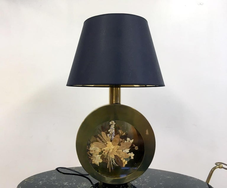 Circular table lamp Brass rim Glass centre with pressed flowers inside  New black shade with gold reflective interior Italy 1970s.