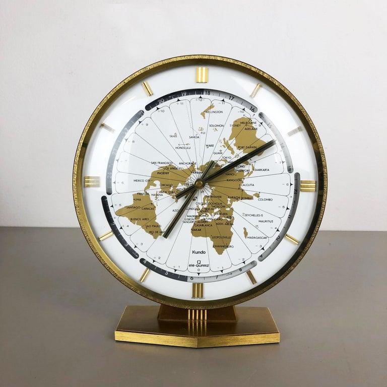 Article:  table clock    Origin:  Germany   Producer:  Kundo, (Kieninger & Obergfell), Germany  Age:  1970s    Description:  This original table clock was produced in the 1960s by the premium clock producer Kundo in Germany.