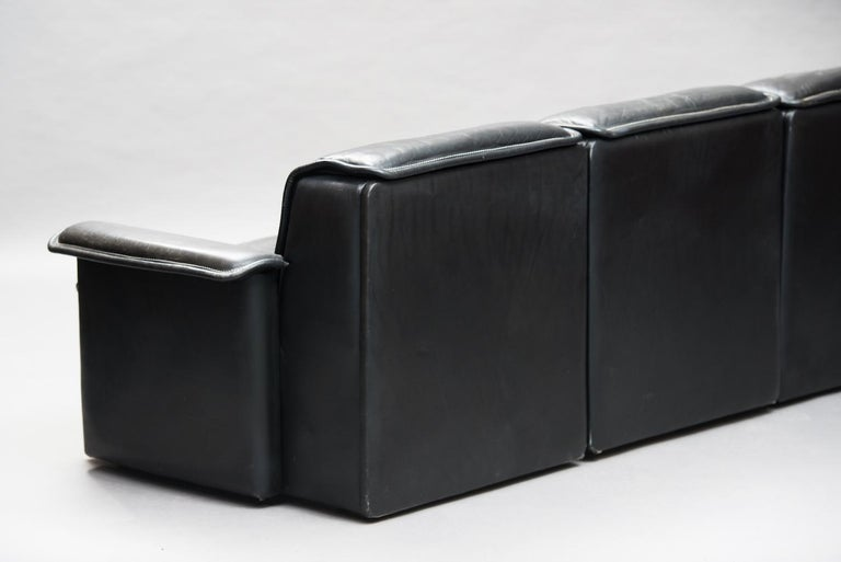 DS 12 three-seat modular sofa in black buffalo leather from the 1970s by De Sede, Switzerland.