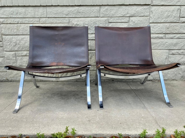 Designed by Preben Fabricius for Arnold Exclusiv, this unique pair is in overall good condition. Original leather. Distressed with scuffs, scratches, and discoloration, please refer to photos for condition. Small leather repair on one chair.