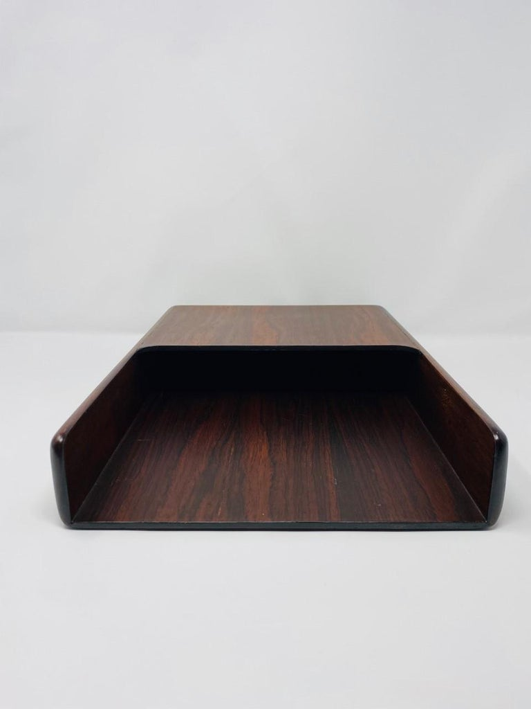 Beautiful 1970s brazilian rosewood paper and letter tray. Chic streamlined design that exhibits the beautiful grain of the wood against clean lines. The piece is lined with felt on the bottom surface. The provenance of this piece might be part of a