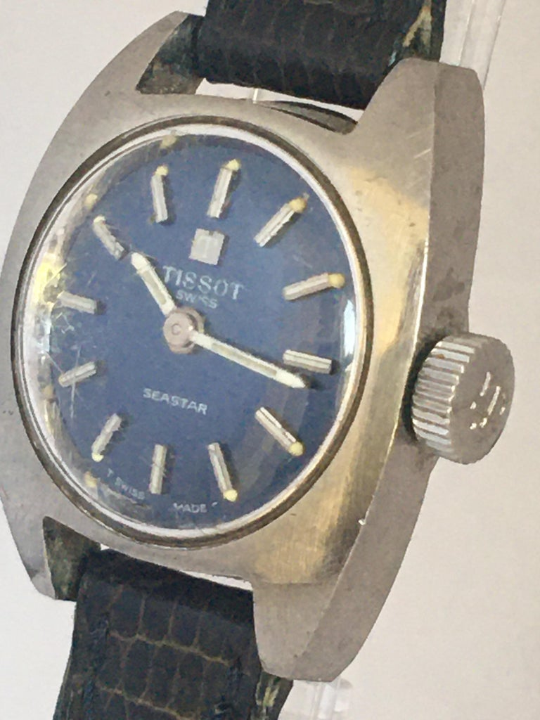 This beautiful pre-owned vintage hand-winding ladies watch is working and is running well and it keeps a good time. Visible signs of ageing and wear with some scratches on the glass and on stainless steel watch case. The old strap buckle is gold