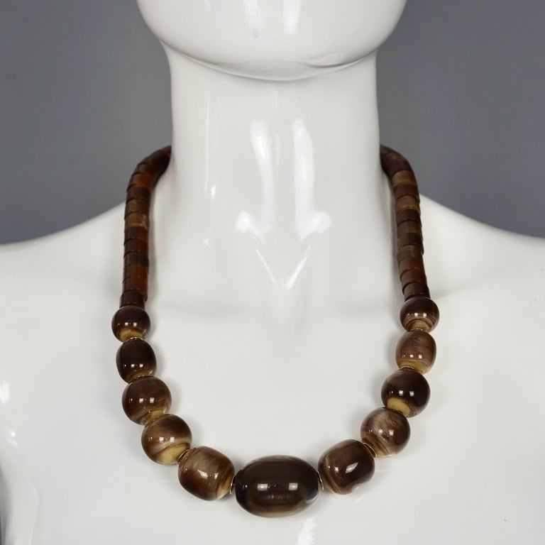 Vintage 1970s YVES SAINT LAURENT Ysl Tigers Eye Necklace by Roger Scemama  Measurements: Height: 1.06 inches (2.7 cms) Wearable Length: 23.22 inches (59 cm) until 24.40 inches (62 cm)  Features: - 100% Authentic YVES SAINT LAURENT by Roger