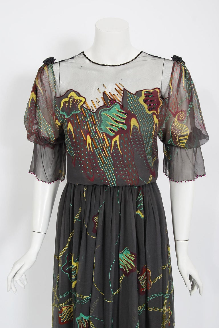 Zandra Rhodes was one of the British designers who put London at the forefront of the international fashion scene in the 1970's. This gorgeous dove grey hand-painted dress dates back to her 1977 couture collection. Her designs are considered