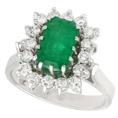 Vintage 1980s Emerald and Diamond White Gold Cluster Ring