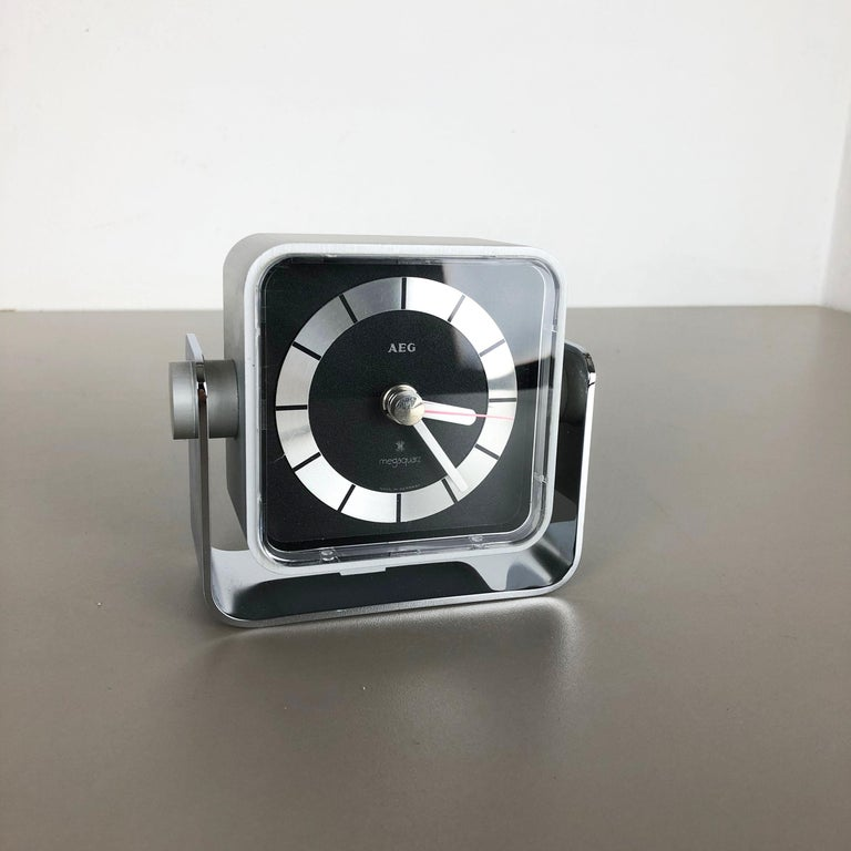 Article:  Table clock    Origin:  Germany   Producer:  AEG   Age:  1980s    Description:  This original metal table clock was produced in the 1980s by the premium clock producer AEG in Germany. The clock is original vintage