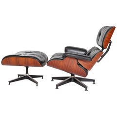 Vintage 1983 Eames Lounge Chair and Ottoman of Rosewood and Black Leather