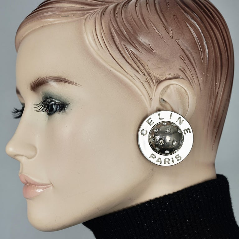 Vintage 1989 CELINE PARIS Rhinestone Planet Sphere Earrings  Measurements: Height: 1.69 inches  (4.3 cm) Width: 1.69 inches  (4.3 cm) Depth: 0.55 inch (1.4 cm) Weight per Earring: 25 grams  Features: - 100% Authentic CELINE PARIS. - Round earrings