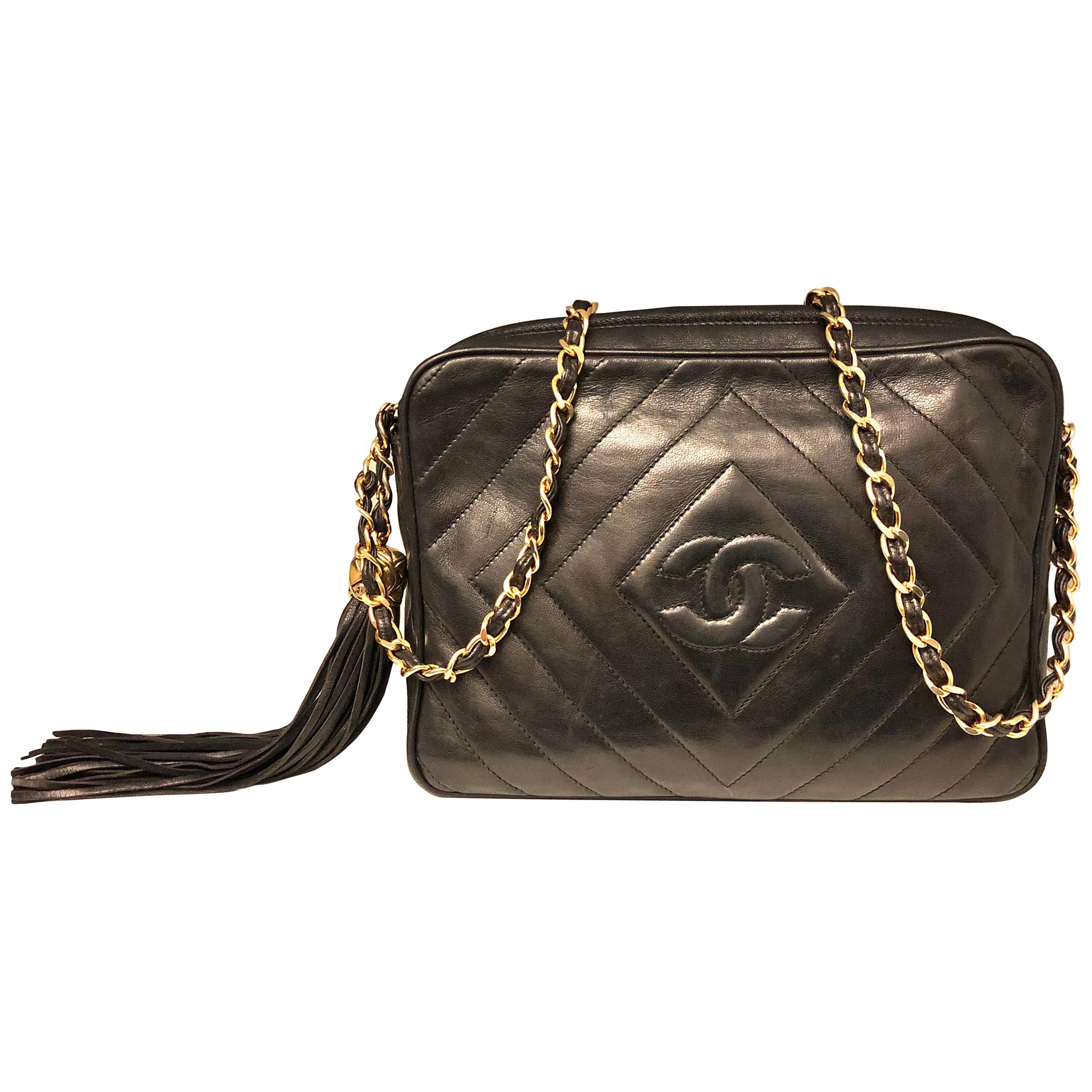 Vintage 1989 to 1991 Chanel black lambskin camera bag with tassel.