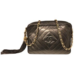 Vintage 1989 to 1991 Chanel black lambskin camera bag with tassel.