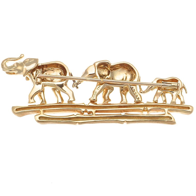 Symbolizing strength & power, wisdom & loyalty, this Cartier elephant menagerie pin is the perfect good luck charm. No other creature has so much stature and power and is yet considered so sweet and adorable. In shiny 18k yellow gold, this magical