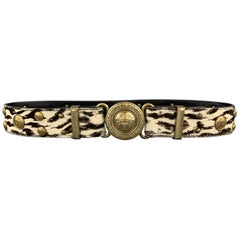 Vintage 1990's GIANNI VERSACE belt features a smooth black leather strap and sil