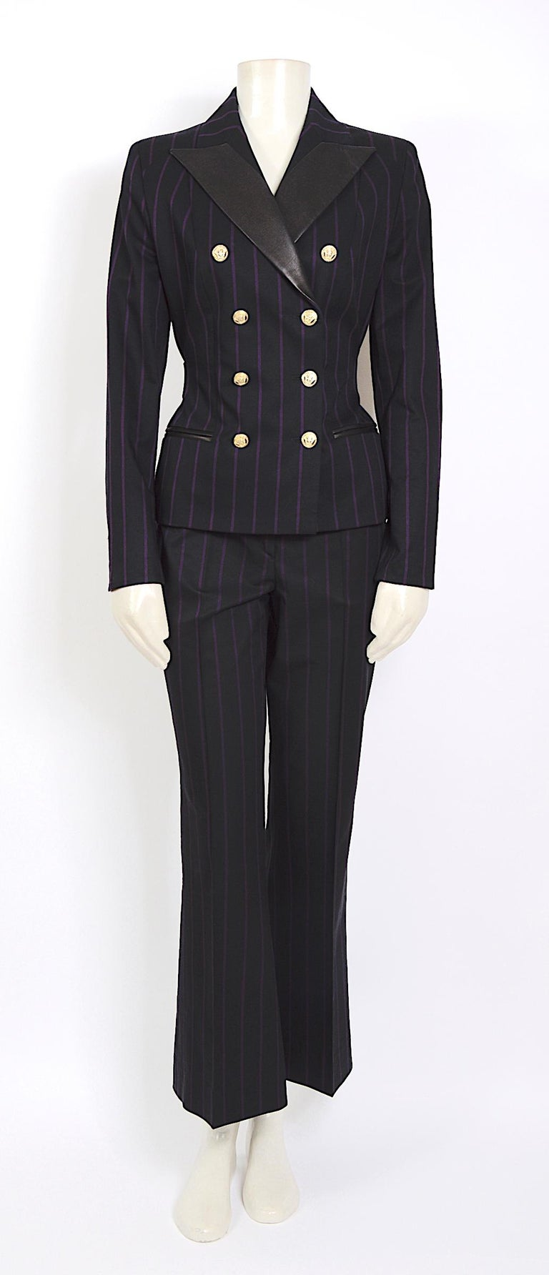 Vintage 1990s Gianni Versace purple striped black suit. made in a mix of 57% wool 42% silk & 2% elastane and leather details at the back/sleeves/collar and the waistband of the trousers The leather backstrap was pinned on the doll for a more fitted