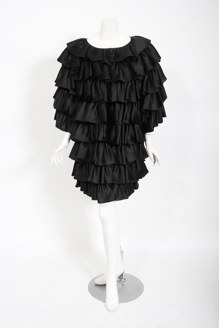 A gorgeous early 1990's Oscar de la Renta black silk tiered-ruffle jacket which cost well over $4,000 when new.   Oscar de la Renta was one of the world's leading fashion designers. Trained by Cristóbal Balenciaga and Antonio Castillo, he became