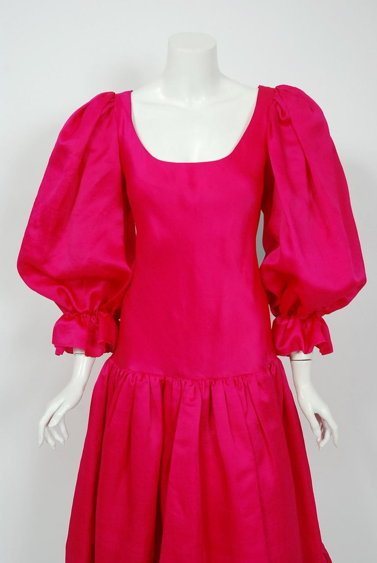 An early 1990's Oscar de la Renta couture shocking pink silk romantic dress which cost well over $4,000 when new.  Oscar de la Renta was one of the world's leading fashion designers. Trained by Cristóbal Balenciaga and Antonio Castillo, he became