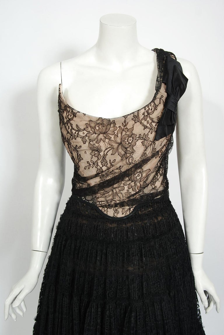 A breathtaking Vivienne Westwood gold label two-piece bustier with matching sheer pleated lace skirt dating back to the mid-1990's. Vivienne Westwood is one of the most influential and recognizable British designers of the past 30 years. She began