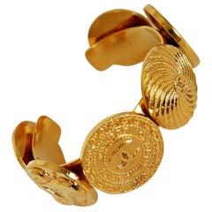 Vintage 1992 Chanel Paris Novelty-Logo Charms Medallion Gold Cuff Bracelet