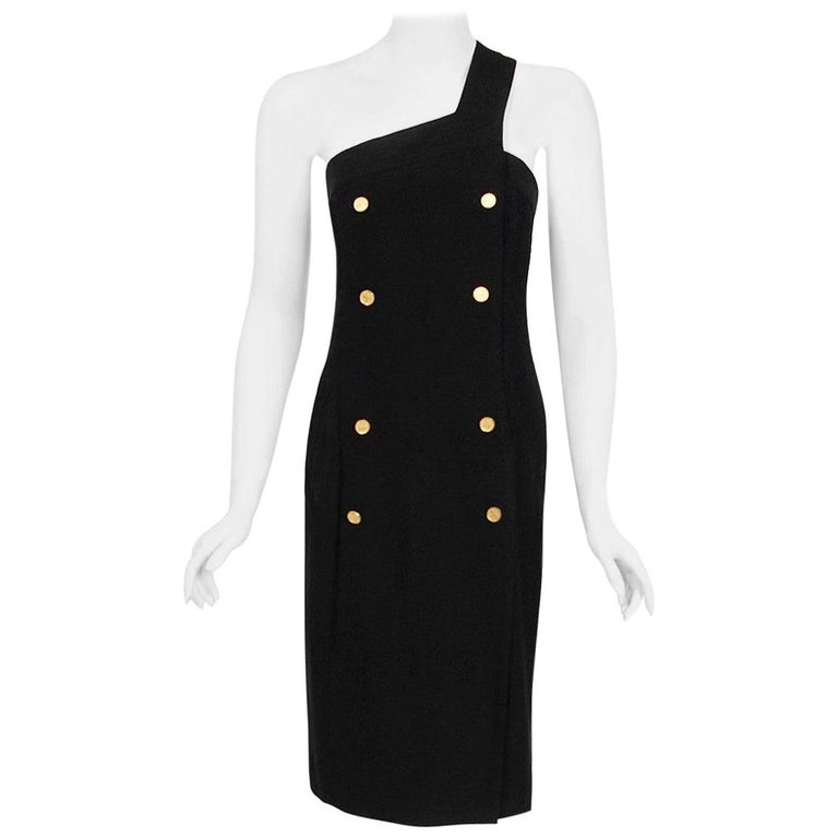 Chanel is known to be one of the most luxurious and decadent fashion houses in the world. This breathtaking black linen cotton dress, from Karl Lagerfeld's 1995 collection for the house, is a perfect example of why this couture brand has stood the