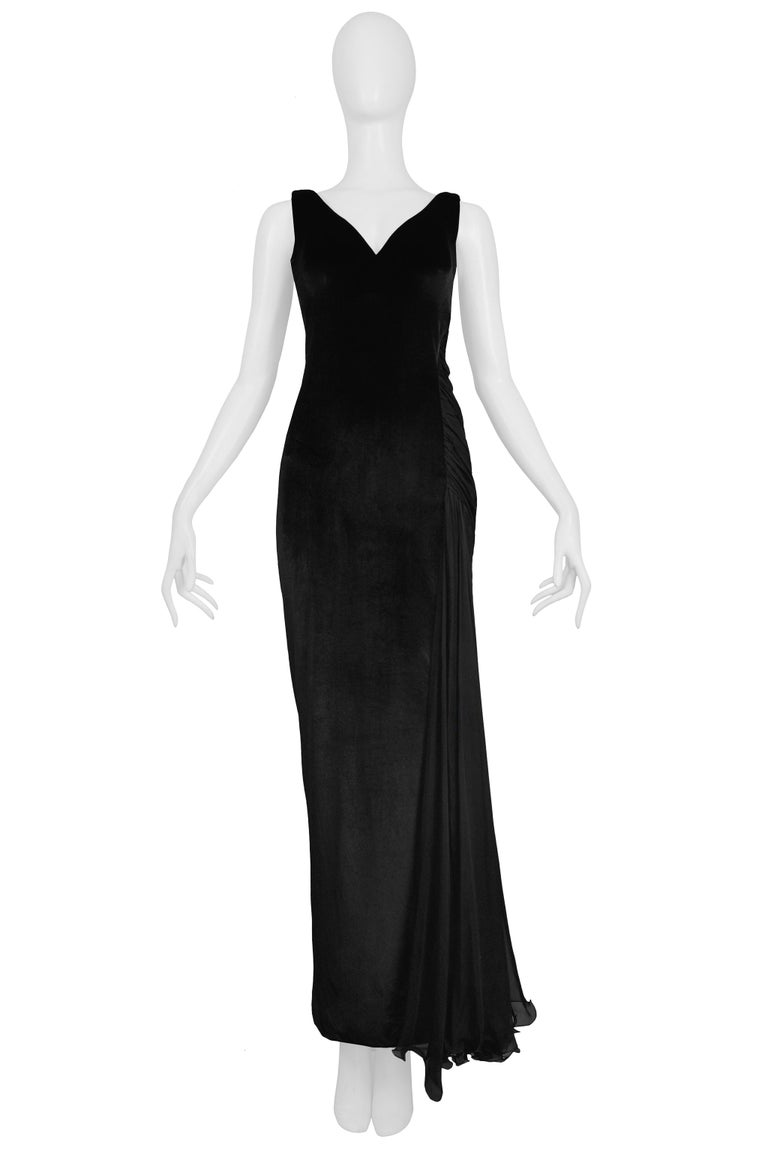 Resurrection Vintage is excited to offer a vintage Versace black velvet evening gown featuring a draped chiffon inset, deep v-neck, and sculpted back panel.   Versace  Size S or 38 Measurements: Approx Bust: 32