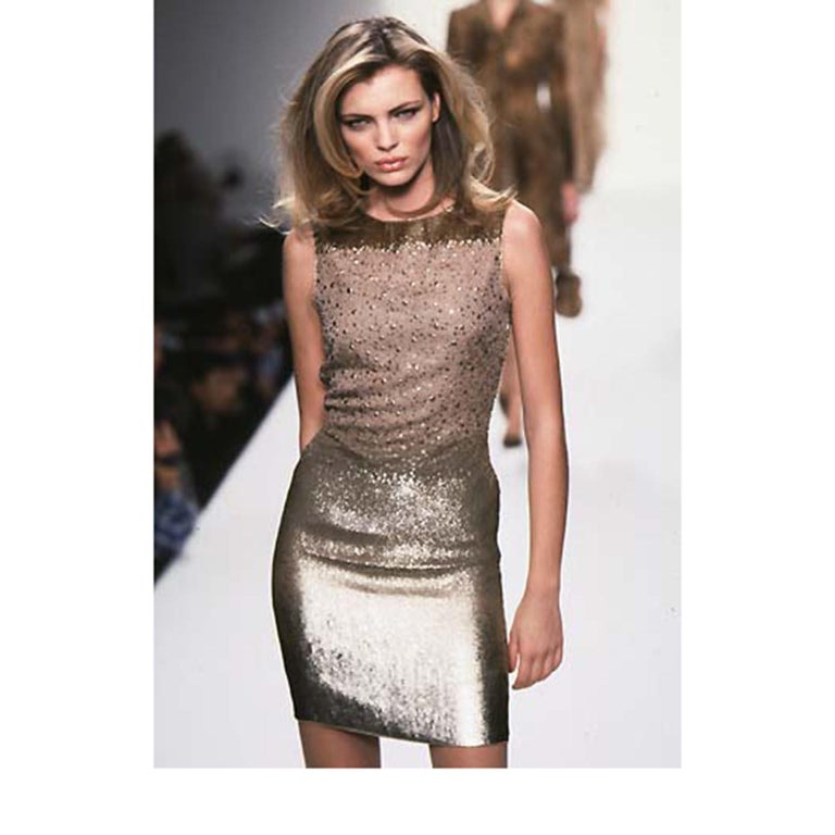 This documented Bill Blass vintage evening dress has gorgeous bronze sequins with a subtle ombre effect.  The dress was featured on the runway in the Bill Blass F/W 1997 collection.  There are bronze sequins on the top of the bodice  and from there