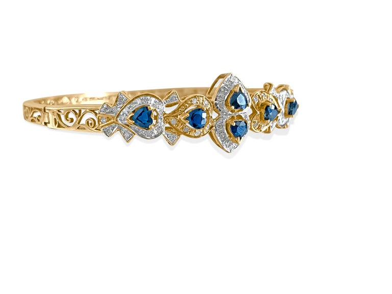 Metal: 14K yellow gold.   2.00 ct blue sapphire total.  100% natural earth mined. Heart shaped blue sapphire.   100% natural earth mined side diamonds. Round brilliant diamonds. Nice shine and luster. Handmade womens bracelet.