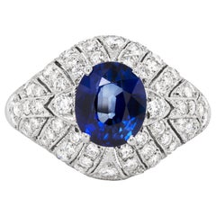 Vintage 2.06 Carat Oval Sapphire and Diamond Cluster Platinum Engagement Ring