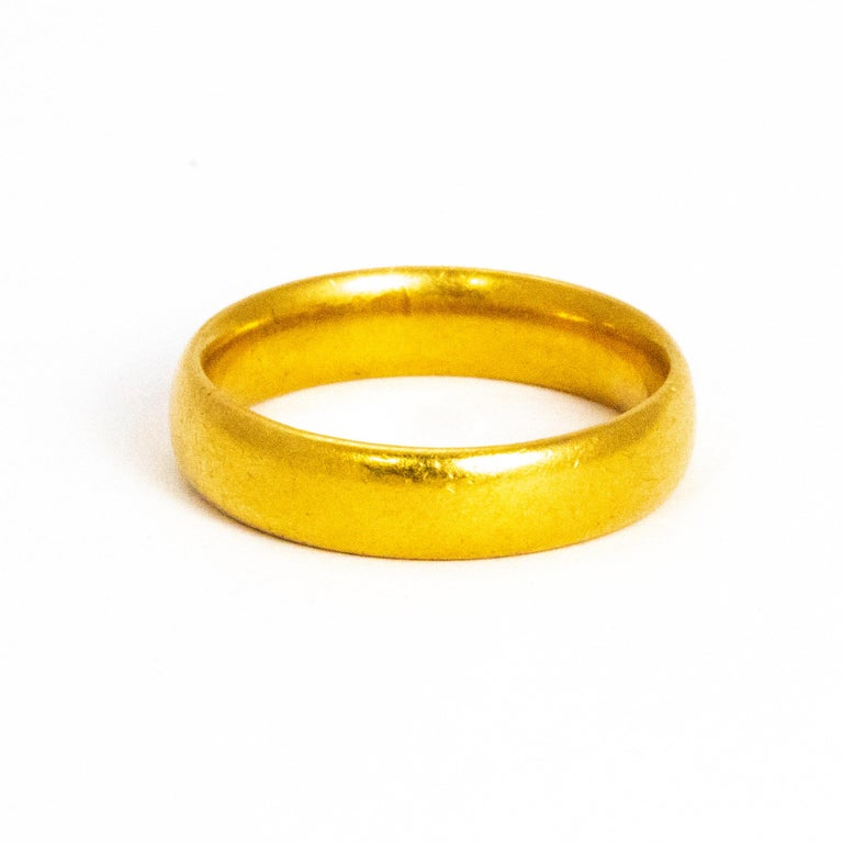 This classic 22ct gold band could be used as a wedding band or a simply lovely everyday ring. Made in Birmingham, England.  Ring Size: M or 6 1/4 Band Width: 4mm