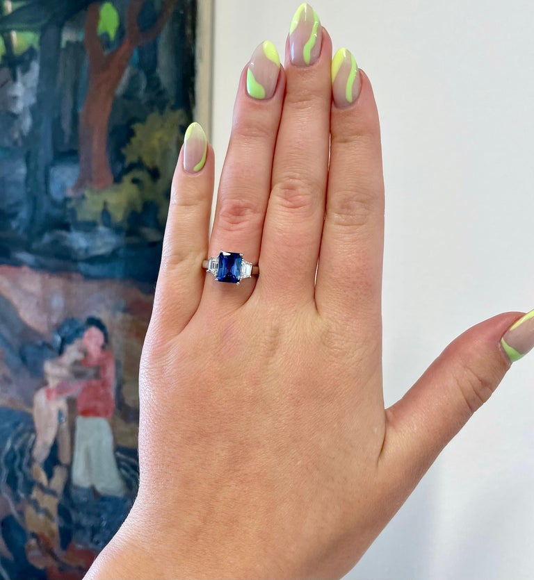 This is the timeless and classic 3-stone design that you will cherish forever. The sapphire and diamond ensemble is the best combination of stones. The bright and vibrant blue color of the  sapphire and the brilliance of the diamond will please you