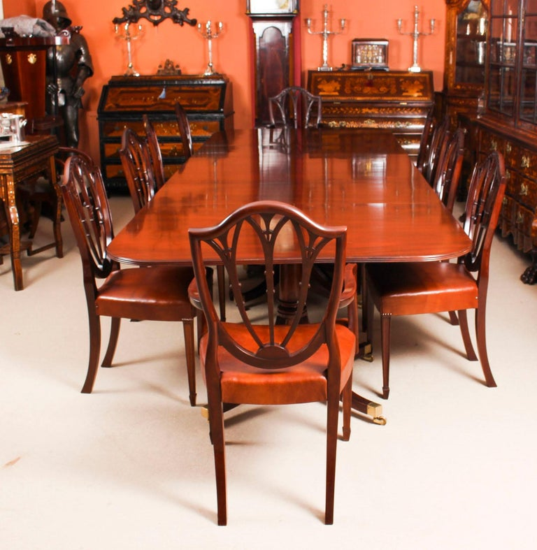 This is fabulous Vintage dining set comprising a Regency style dining table by William Tillman, circa 1980 in date and an antique set of ten Hepplewhite dining chairs C1880 in date.