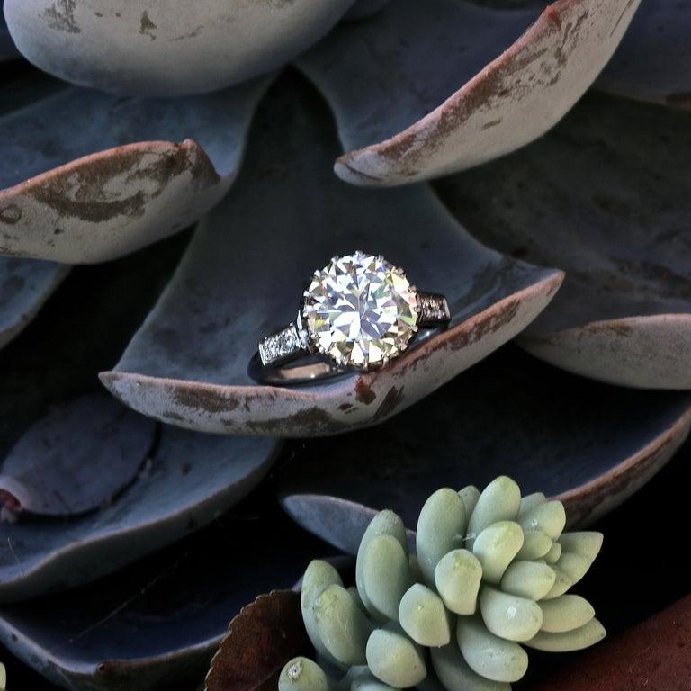 A spectacular low profile ring from the 1950's. If stone size is important to you, this ring offers a larger stone for a reasonable price. The timeless classic beauty features a 3.67 round cut diamond, graded Q-R color, VVS clarity. With 4 round