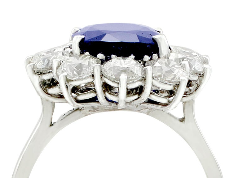 A stunning vintage 4.29 carat sapphire and 1.80 carat diamond, 18 karat white gold cluster ring; part of our diverse vintage jewelry and estate jewelry collections.  This stunning, fine and impressive vintage sapphire and diamond ring has been
