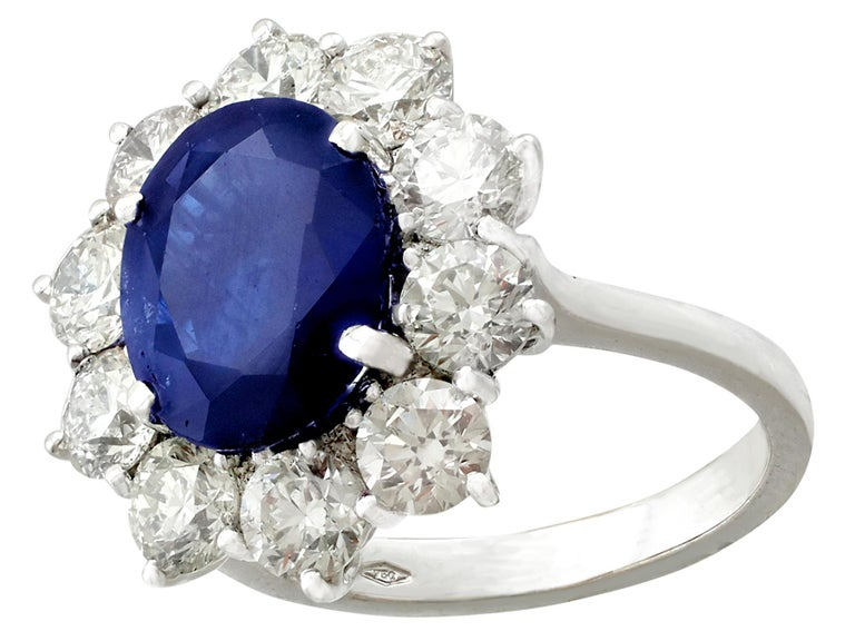 Round Cut Vintage 4.29Ct Sapphire and 1.80Ct Diamond White Gold Cluster Ring  For Sale