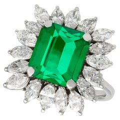 Vintage 4.30 Carat Emerald and 3.24 Carat Diamond White Gold Cluster Ring
