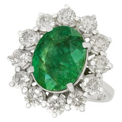 Vintage 4.82 Carat Emerald 3.12 Carat Diamond White Gold Cluster Ring
