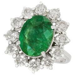 Vintage 4.82 Carat Emerald 3.12 Carat Diamond White Gold Cluster Ring