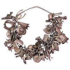 Vintage 50 Piece Sterling Silver Charm Bracelet Great Estate Jewelry Find