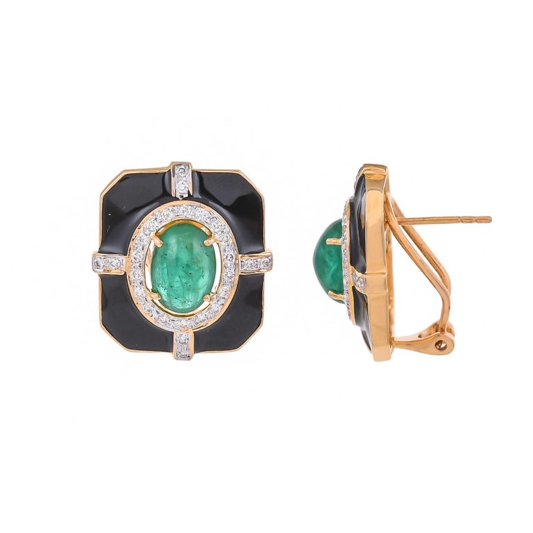 Modern and stylish this 18 karat earring features a bold, geometric shape set with the eccentric combination of 5.69 carats emerald surrounded by sparkling white 0.70 carats diamonds and solid black enamel, highlights this statement yellow gold