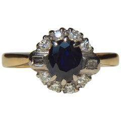 Vintage .61 Carat Sapphire Diamond Halo 18 Karat Gold Engagement Ring