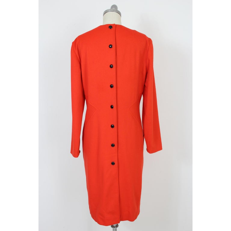 Vintage women's 70s dress Dani. Red long evening dress, 100% pure wool. Closing with black buttons over the entire length of the dress, V-neckline, pockets on the sides. Made in Italy. New with tag.  Size: 46 It 12 Us 14 Uk  Shoulder: 46