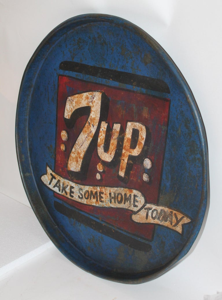 Fantastic and aged 7up soda tray in original age and worn paint. This is a oversized tray and does have pit marks and distressed in areas.