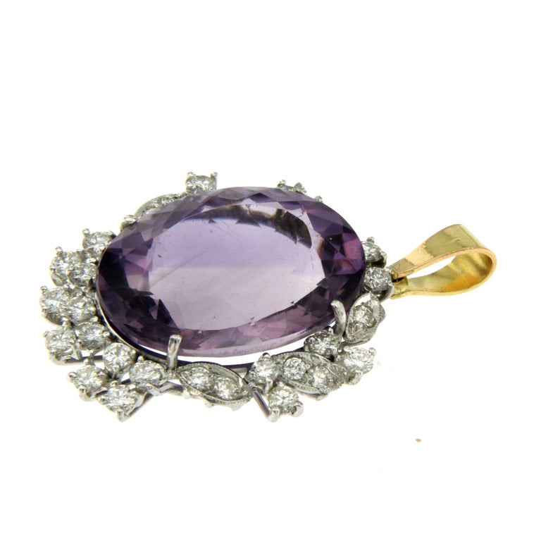 18k White and Yellow Gold (only the bail in yellow gold) Amethyst Diamond Pendant Necklace  This piece is crafted from 18k gold and weighs 7,35 grams. It features a beautiful Amethyst 9 carats surrounded approximately 1.50 ct Sparkling Round