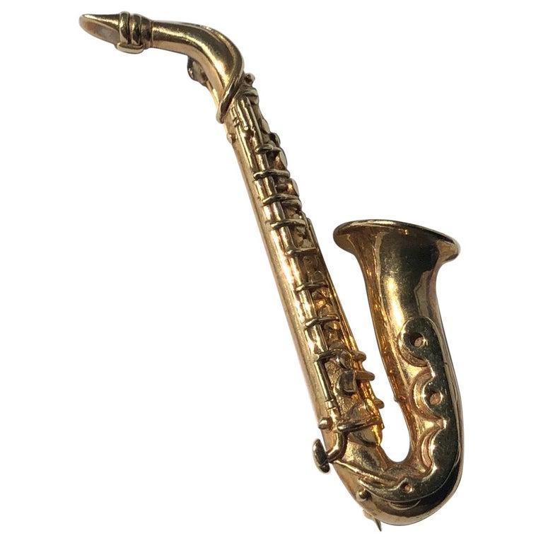 Vintage 9 Carat Gold Saxophone Brooch For Sale
