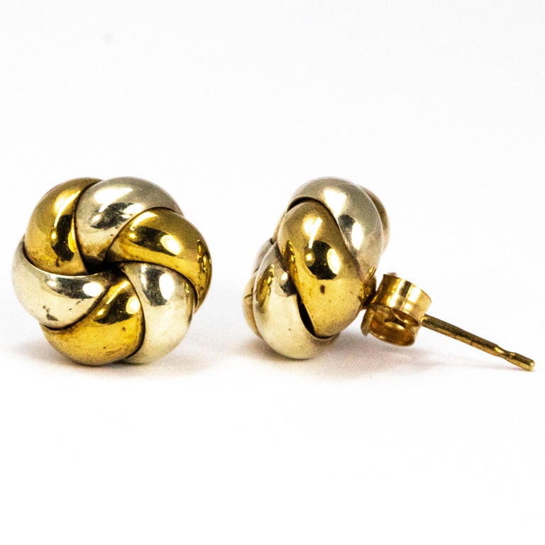 These earrings are created using folds of gorgeous glossy white and yellow gold which model a knot design.   Knot Diameter: 10.5mm