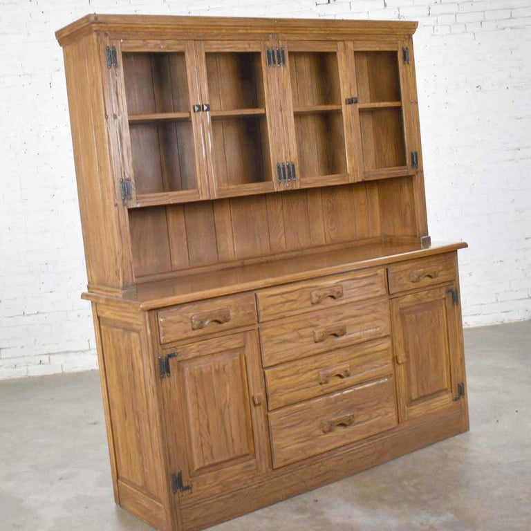 Handsome vintage western or rustic style Ranch Oak sideboard or china cabinet or hutch cabinet by A. Brandt. It is in wonderful vintage condition. We have not found any outstanding flaws only normal wear for age. Please see photos, circa mid-20th